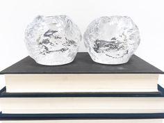 Kosta Boda snowball candleholders, a pair
