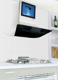 Watch TV while you cook! The stylish stainless steel Vela Range Hood from ILVE, made by Italian designer Marco Valerio Agretti, features a set of touch screen controls and a built-in LCD TV. Kitchen Hood Design, Kitchen Hoods, Kitchen Appliances, Kitchen Cooker, Cooker Hoods, Cool Kitchens, Home Goods, Tv, Stylish