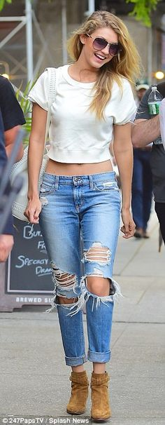 Casual cool: The 20-year-old model paired her distressed denim with a white cropped T-shir...