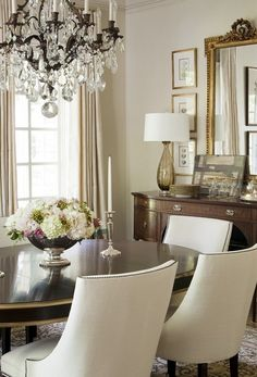 dining room....chandelier, chairs, buffet