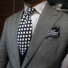 Very clean look. The jacket becomes a nice pallet for the fun and eye popping tie, anchored by the kerchief...