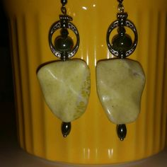Lemon yellow quartz and gunmetal dangles This Beautiful pair of Earart is striking in person! pictures don't do them justice. Arrow shaped quartz, has a green hue to it also. All made of high quality beads and hardware  (gunmetal hardware )Handmade By me with tons of Love ❤ All 1 of a kind designs! =) #greatdeal #hotlook #UwilllookMarv #Classylook #Sassy #Earart #shiny #strikinglyBeautiful #Shinelikeastar #Oneofakind! Mine  Jewelry Earrings
