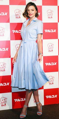 Miranda Kerr in a crisp light blue shirtdress and a pair of matching sky blue stacked heels.
