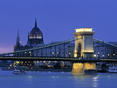 The Chain Bridge at night along the #Danube. The tower of Buda Castle stands behind it. #Budapest #Hungary