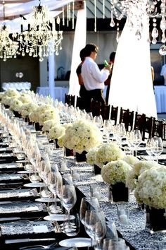 Inspiration of The Day, love the contrast of the flowers with the black vases, glass, black and white pattern of table cloths and napkins, black chairs