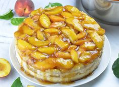 Baked peach cobbler cheesecake with peach topping. Peach Cobbler Cheesecake is the most amazing combo or soft and creamy New York Style Cheesecake and classic southern Peach Cobbler, packed in one decadent dessert. Peach Cobbler Cheesecake Recipe, Peach Cobbler With Bisquick, Homemade Peach Cobbler, Southern Peach Cobbler, Cheesecake Recipes, Dessert Recipes, Cheesecake Deserts, Cheesecake Dip, Homemade Cheesecake