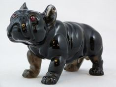 Faberge carved obsidian bulldog with cabochon ruby eyes.