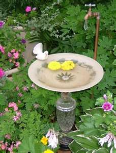 Trash to Treasure bird bath, i made one this summer, from an old lamp, the lil birdies loved it!