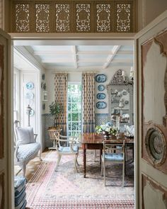 Antique confessional doors lead into the dining room. | Photo: James Merrell; Design: @cathykincaidinteriors #verandadiningrooms