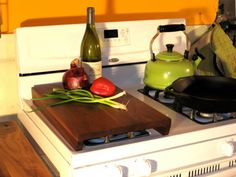 Stove Chop ... what a great use of space! I always end of putting cutting boards on the burners. This would make it a lot sturdier!