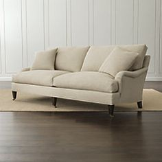 The Essex furniture collection is inspired by formal British tradition, but its streamlined profile is purely in the moment. The sofa's flowing roll arms gracefully frame cushions lofted with down and feathers for sink-in, living room comfort, while seat cushions scaled generous and deep relax you into high back cushions angled for comfort.