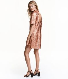 Bronze-colored. Short, straight-cut dress in sequin-embroidered mesh. Short sleeves, small stand-up collar with snap fasteners at back of neck, and low-cut