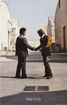 """A great poster of the enigmatic Hipgnosis album cover art from the Pink Floyd LP Wish You Were Here! Ships fast. 11x17 inches. Take some """"Time"""" to check out the rest of our amazing selection of Pink F"""