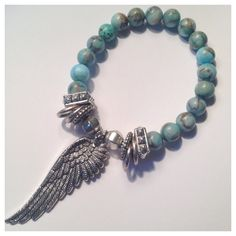 Beautiful mixtures turquoise beads finished with silver toned spacer beads and silver toned wing charm.