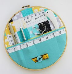 Sewing wall storage using an embroidery hoop - I can also picture this for make-up storage or computer storage