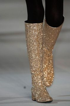 These boots are made for walking.   Details at Yves Saint Laurent for Fall 2014