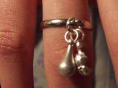 This is one of my hand made dangle rings. This is a silver tone adjustable band with a silver tone tear drop and clam shell with faux pearl inside. $15