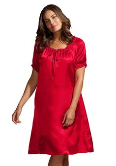 """Romantic and beautiful, what's not to love about satin? This sleepshirt is unparalleled when it comes to comfort and beauty. This is the prefect nightgown for someone looking for comfort infused with feminine flair.  front & back shirring with straight silhouette shirt 38"""" long, falls above the knee keyhole neck with tie short, elasticized sleeves delicate ruffles at peasant neck washable, woven satin polyester, imported perfect with our short robes pair with your favorite ..."""