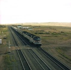Union Pacific, along with most other U.S. railroads, transferred its passenger service to Amtrak in 1971. An Amtrak train is pictured here on UP triple track in Wyoming.