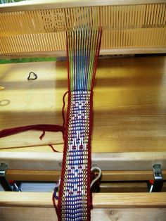 weaving a band on a rigid heddle.  Maybe could do inkle weaving?
