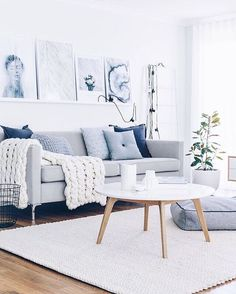 White and grey with a slight blue tinge - love the sofa in this dreamy sitting room/lounge