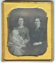 Mother and twin sister with post mortem infant photo circa 1850's. So touching. You can see the sister showing comfort & support as she takes her sister's arm, and the poor mother looks as if she's been crying, of course. I think seeing these today is important as it makes our ancestors real...real people with real hard times, feelings, losses. We're all still connected.