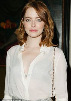 Bra-vo: The actress flashed her glittering silver bra, which matched her pencil skirt, and also wore a slightly sheer white shirt