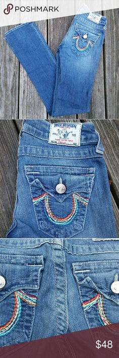 True Religion Rainbow Jeans Notoriously popular jeans that make your booty pop. CONDITION: Like new, very minor wear on backside but hard to notice.  STYLE: Straight Leg MEASUREMENTS W - 25 H - 29 Inseam - 33  Please ask any questions before purchasing - thank you! True Religion Jeans Straight Leg