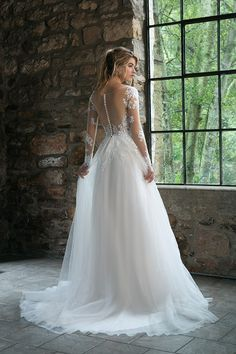 76007c1b308 Long sleeve a-line wedding dress with illusion lace sleeves and sheer  illusion back.