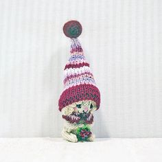 Tiny Sheep in crimson cap with a raspberry knitted sheep