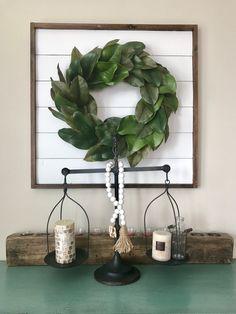 Shiplap sign. magnolia wreath. decorative scale and wood candle holder. Farmhouse decor.