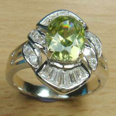 Massjewelry - Oval Cut Olive Green White CZ 925 Sterling Silver Rhodium Cocktail Ring