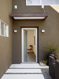 love the stucco and light overhang above door