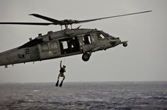 An MH-60S Sea Hawk helicopter demonstrates a search and rescue operation