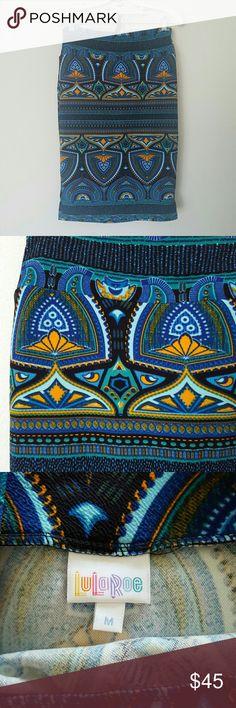 LulaRoe Cassie Skirt Made in USA. Blues, Greens, Yellow Orange on Black Background. Worn Once. Washed to LLR Specs. LuLaRoe Skirts Midi