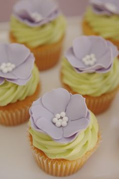"""Flower cupcakes are a beautifully delicious treat! They are a little something """"extra"""" outside of the normal cupcake. Plus you can get them custom made with your Valentine's favorite colors. My favorite color is purple which I why I picked these :-) Pretty Cupcakes, Beautiful Cupcakes, Yummy Cupcakes, Cupcake Cookies, Spring Cupcakes, Floral Cupcakes, Mocha Cupcakes, Cupcake Wars, Gourmet Cupcakes"""
