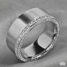 Men deserve diamonds too! This handsome Custom Comfort Fit Wedding Band is packed with 0.90ctw A CUT ABOVE ® Hearts and Arrows Diamond Melee. The 8mm band is finished off a satin finish.