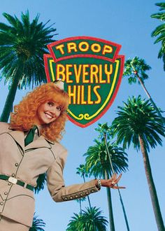 Troop Beverly Hills. A spoiled housewife decides to lead her daughters wilderness group in order to prove to her husband that she is not a trophy wife. I'm sure a ton of people think this movie is lame, but I saw it when I was younger & I've always loved it. I think it's cheesy & goofy & I love it.