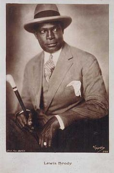 Louis Brody (M'bebe Mpessa) born 1892, in German colony of Kamerun) - actor, musician, wrestler. His career began in the 1920s and lasted till his death in 1952. Brody did political work supporting Afro-Germans via the African Aid Organisation. In 1938 he married a black woman from Danzig. Unlike many colleagues and friends, he survived the Nazi regime while remaining active and successful as an artist. His roles often emphasized the racial stigmas against blacks in Germany at the times.