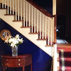 entry with staircase wall painted Fine Paints of Europe's Sapphire, paint companies' favorite colors for 2015