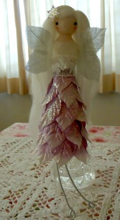 Winter fairy using flower craft leaves for the skirt and wings