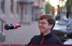 I wish I had the AFTER picture from this scene.  I'm guessing the coke bottle faired better than guy smiley.
