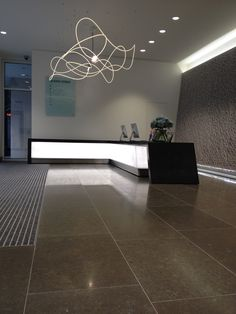Bespoke concrete reception desk cladding by MASS, joinery by eximiousfurniture.co.uk, designed by Trehearne Architects, spec: Black colour match