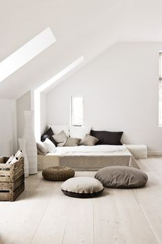 This is a great bedroom for me. Relaxing, easy to clean, beautiful, natural light from skylights and windows, white, grays, linen, and architecturally interesting white walls and large planked floors.