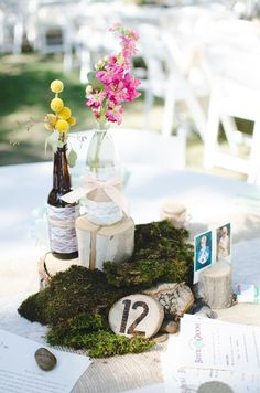 Twine wrapped bottles, mason jars, fresh moss, river rock, wood pieces, lace and burlap