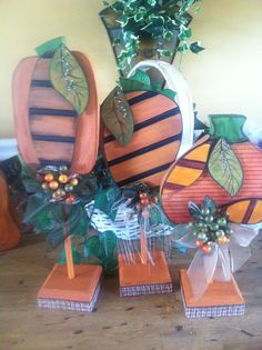 Halloween Pumpkin Trio on stands ... Hand painted and finished on the back side... great center piece or add to your Mantel for a finished touch in Halloween decor  Flat Rate PRIORITY SHIPPING