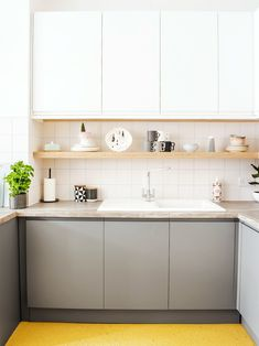 neutral plywood kitchen with yellow floors