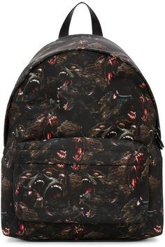 Givenchy - Black Nylon Monkey Backpack $1420 USD  Nylon backpack in black. Signature monkey pattern printed throughout. Buffed leather trim throughout. Adjustable padded shoulder straps. Zippered compartment at face. Leather ID holder featuring logo stamp in gold-tone at back face. Two-way zip closure at main compartment. Zippered pocket at interior. Silver-tone hardware. Tonal stitching.