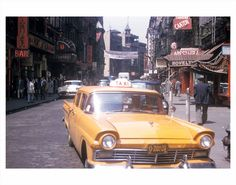 Classic Yellow taxi passing through Chinatown, 1950s.