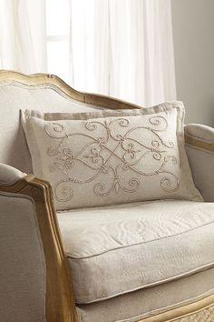 Beaded Scrollwork Pillow Lovely on its own or layered with other pillows, our Beaded Scrollwork Pillow adds a touch of luxury and elegance to the bed. Masterfully crafted with